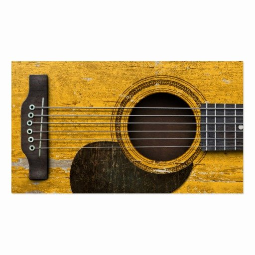 Aged and Worn Old Acoustic Guitar with Pickguard Business